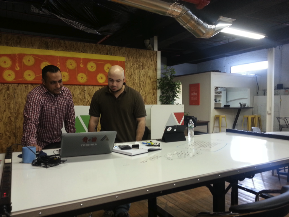 A software developer and marketing strategist collaborate at Running Start. Photo by Noah Goldfarb