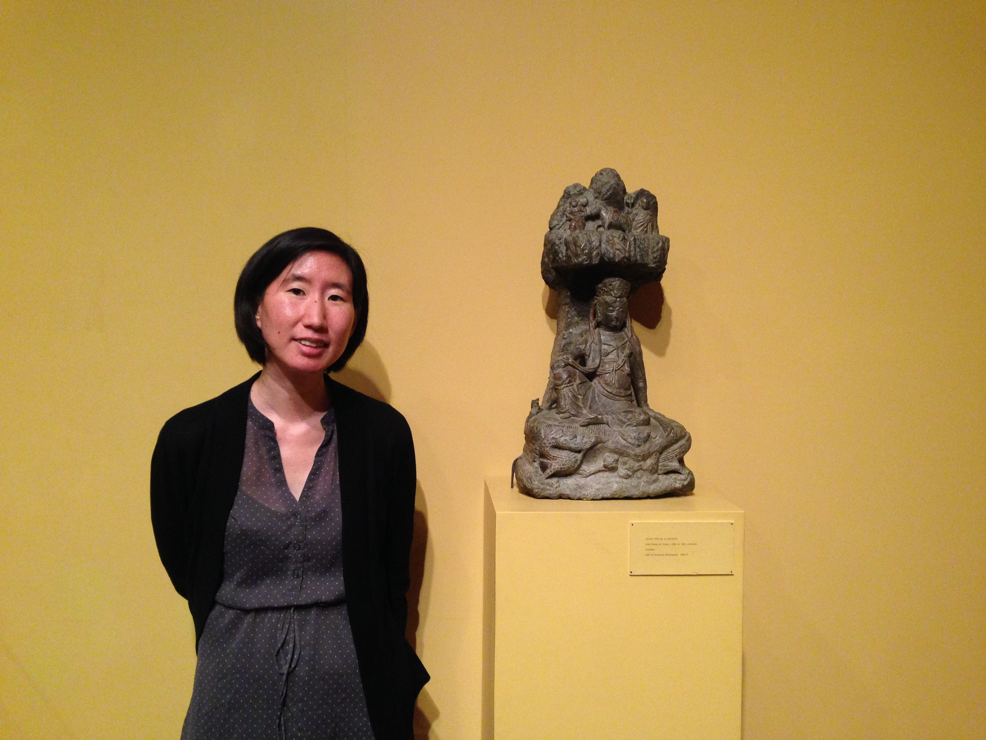 WAM Assistant Curator of Asian Art Vivian Li with Guanyin Seated in a Grotto.